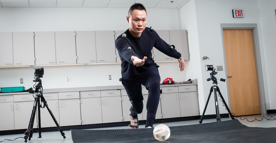 A Man throws a ball while being tracked by the BSU biomechanics lab
