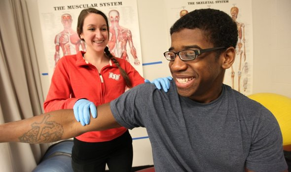Athletic training student with patient