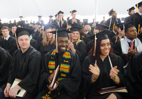 Students clap at commencement