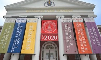 Boyden Hall with 2020 Commencement flags