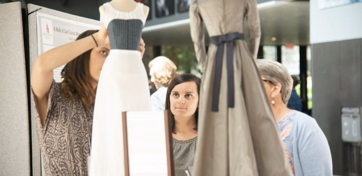 BSU student presenting research on Late Victorian women's fashion at symposium