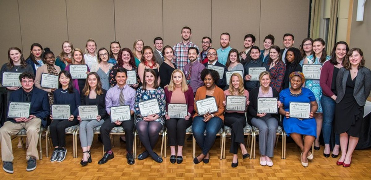 Spring 2018 graduating honors students holding certificates