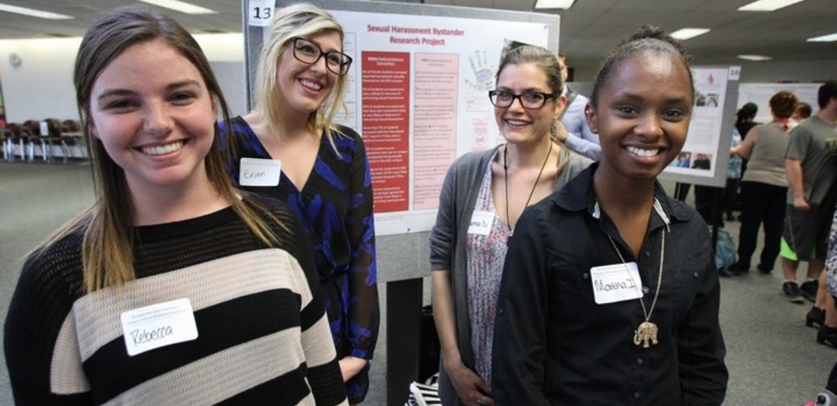 BSU students giving poster presentation on Sexual Harassment Bystander research at spring symposium